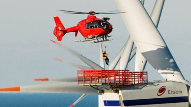 Helicopter flying man in