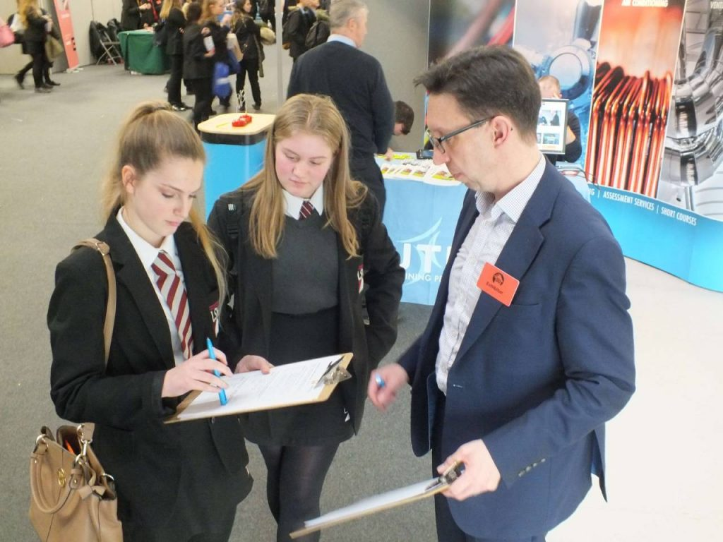 Students at skills event talking to an advisor